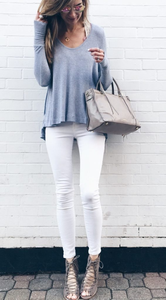 spring outfit idea: free people thermal with white skinny jeans and lace up booties
