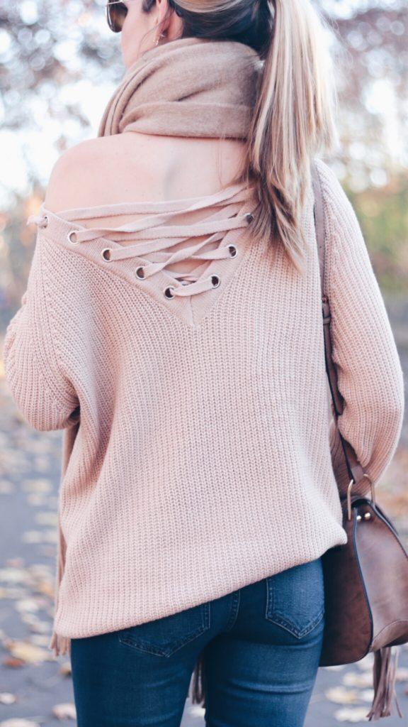 reversed lace up sweater and denim leggings