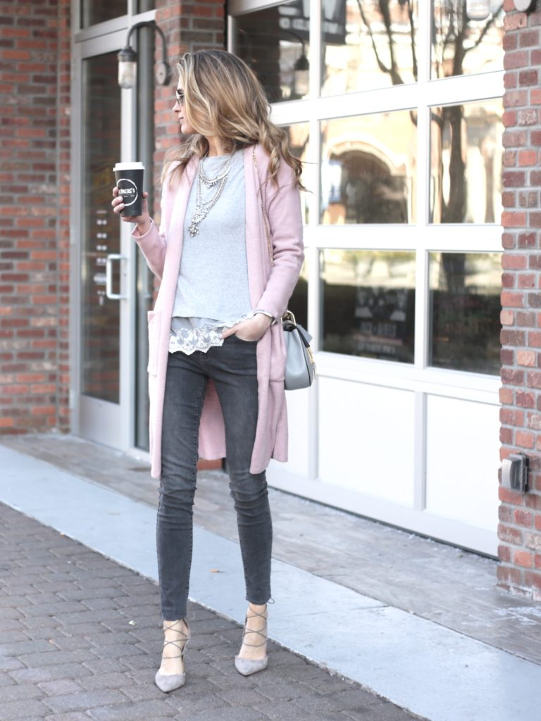 winter outfit: long pink sweater cardigan with gray skinny jeans and heels