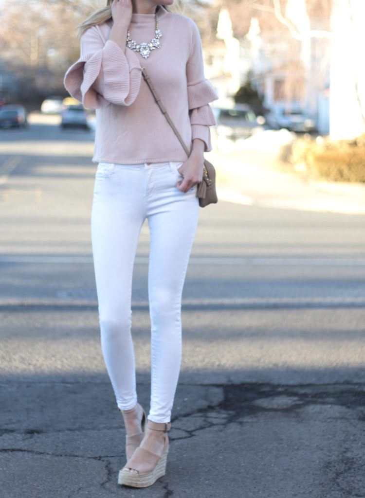 Connecticut life and style blogger, Pinteresting Plans shares 9 pink spring outfits and how to style them. You can check out those and more! spring outfit: pink ruffled bell sleeve sweater with white skinny jeans