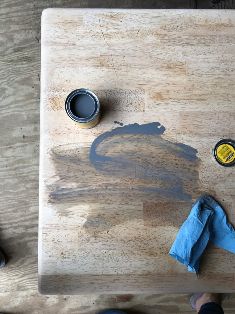 farmhouse coffee table makeover - gray stain on sanded tabletop