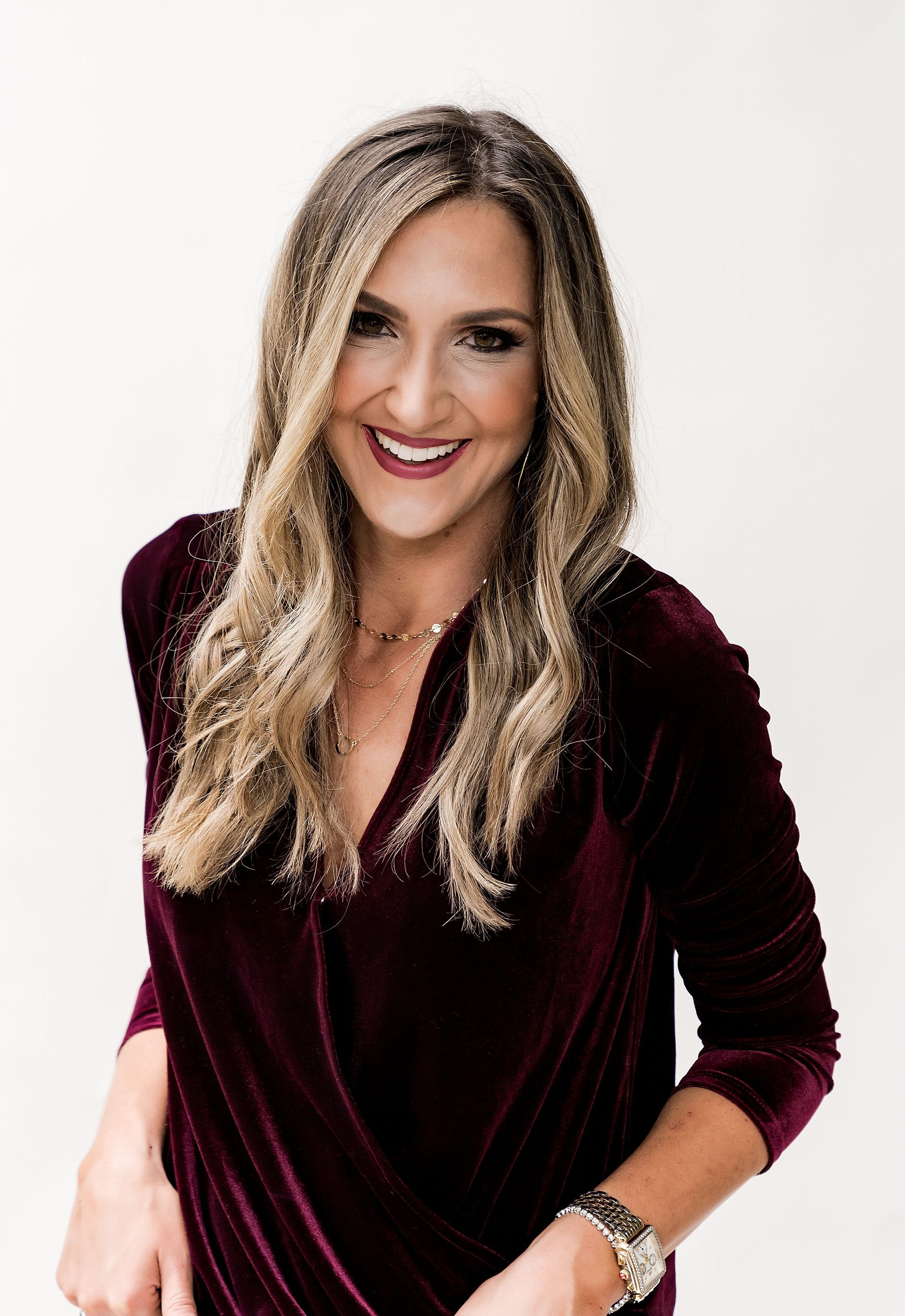 gibson glam holiday outfit ideas - the MALLORY velvet wrap top in burgundy