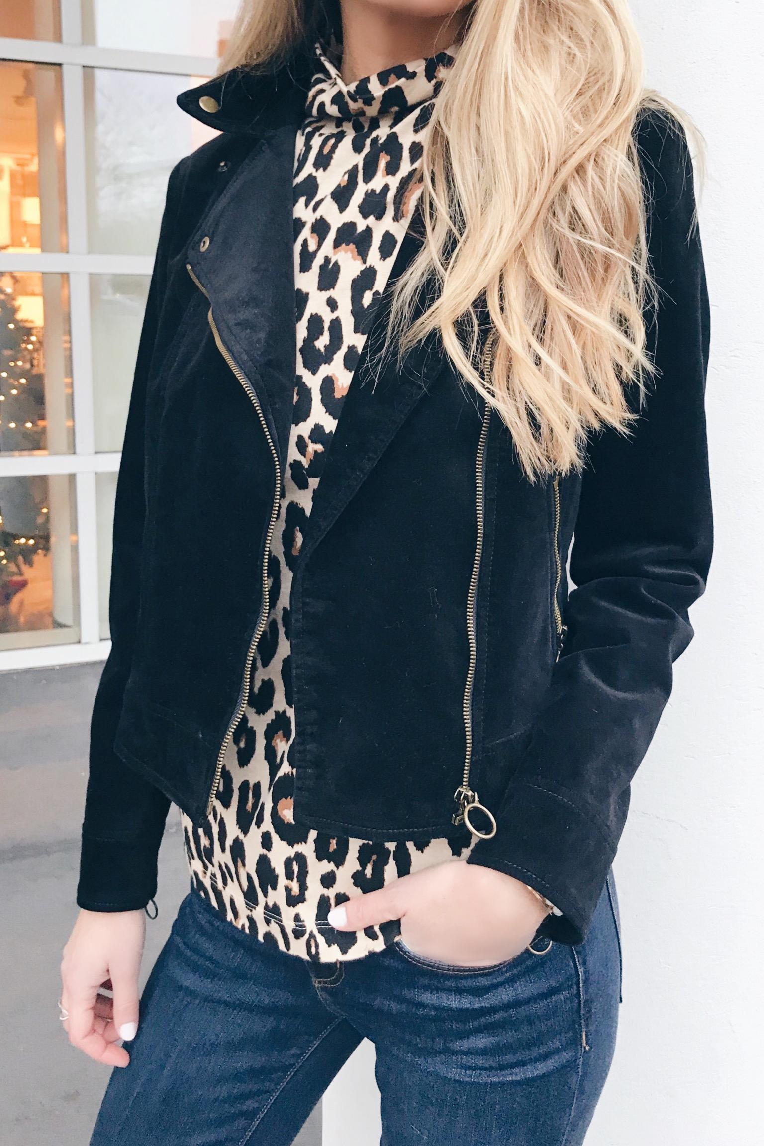 leopard turtleneck and black velvet moto jacket - leopard holiday party outfits