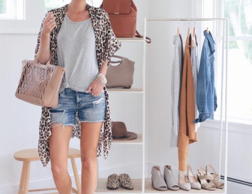 fashion blogger wearing leopard kimono with denim shorts and sole society handbag