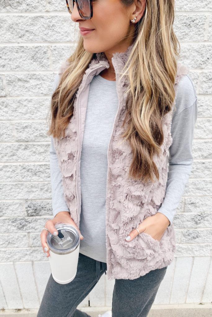 fashion blogger wearing jockey reversible faux fur vest