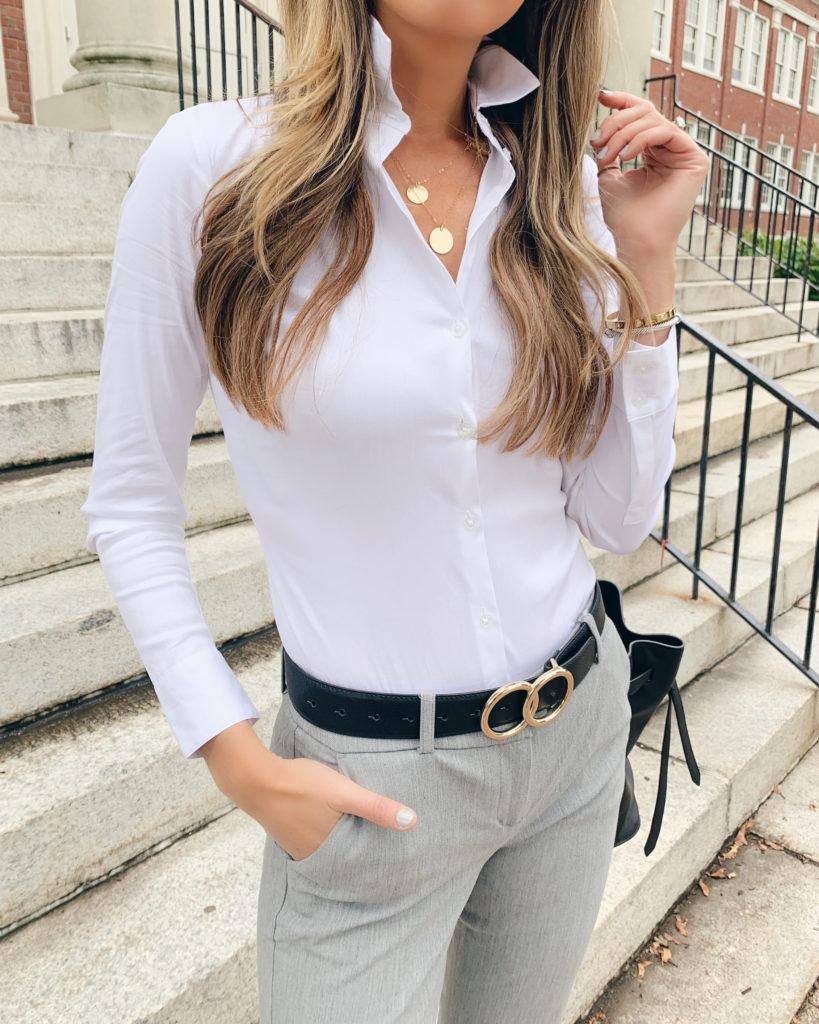 Fashion blogger wearing express business casual long sleeve shirt bodysuit