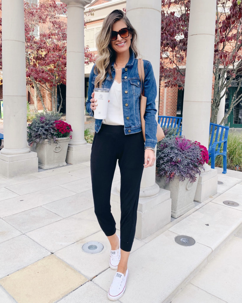norstrom sanctuary kyle crop denim jacket with white lace cami black joggers and converse sneakers