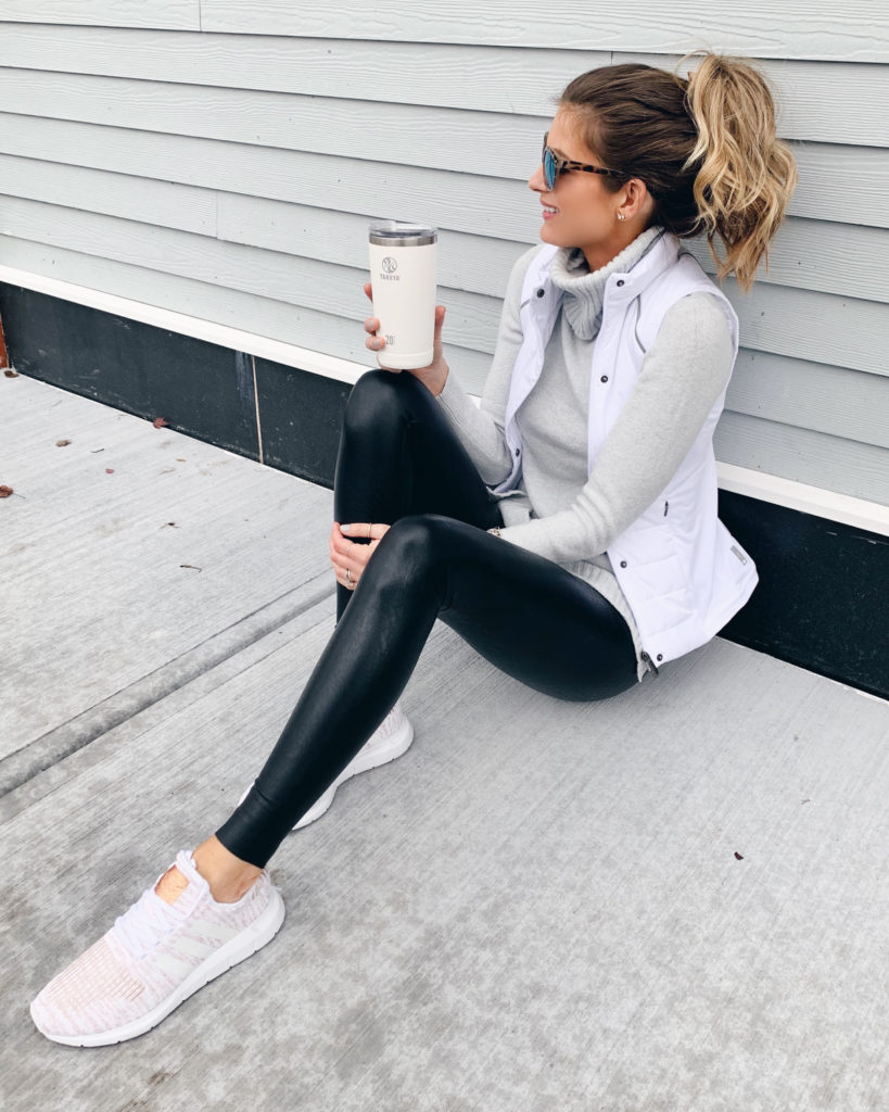 how to wear black faux leather leggings with casual athleisure wear