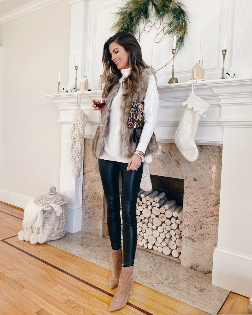 new years eve outfit ideas - white turtleneck sweater with faux fur vest black vegan leather leggings and sole society walnut simeona block heel booties