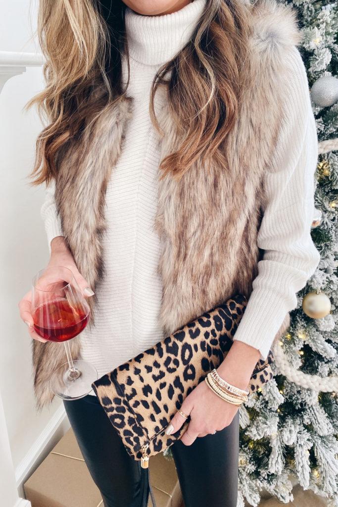 amazon white turtleneck sweater with  faux fur vest spanx black faux leather leggings and victoria emerson boho wrap bracelet