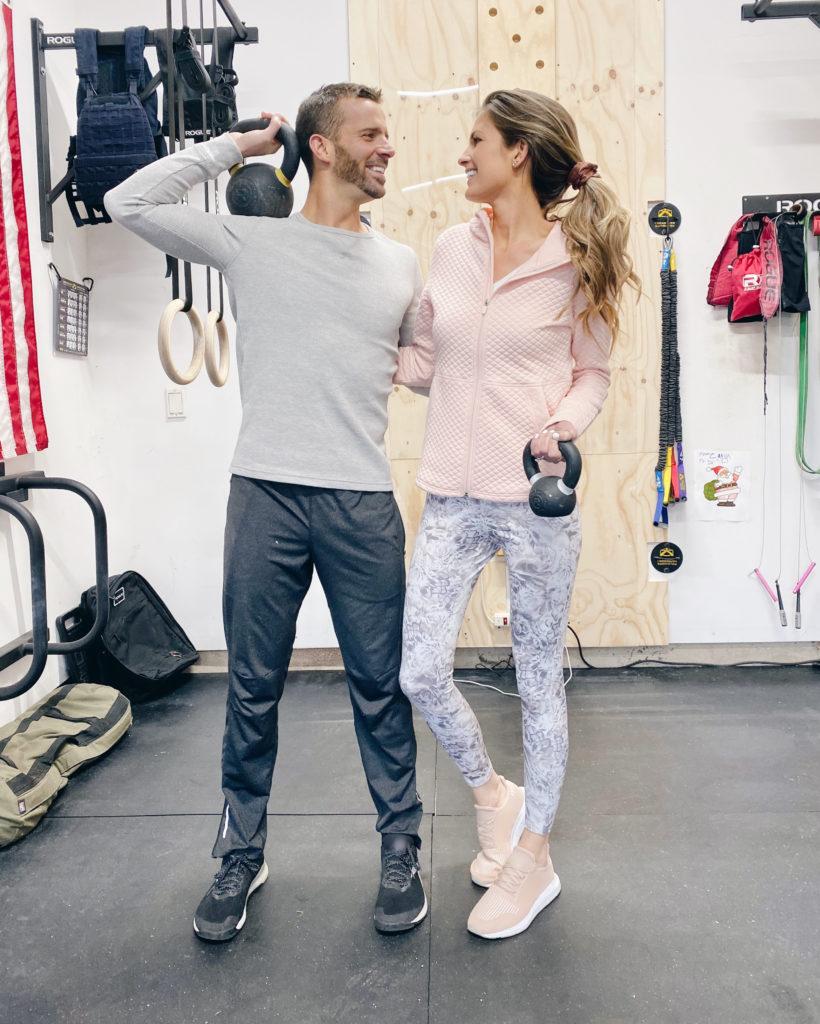pinteresting plans blogger Rachel Moore in CrossFit gym in jacket floral leggings