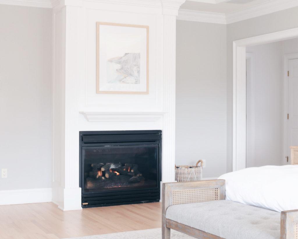 modern master bedroom with framed art  above fireplace - pinteresting plans blog