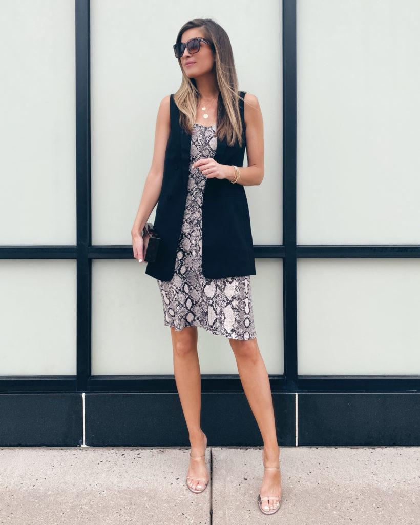 styling a snakeskin midi slip dress with a black sleeveless blazer vest
