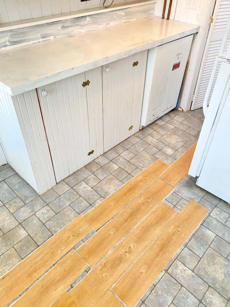 EASY DIY - Peel and stick flooring makeover - Pinteresting Plans Blog