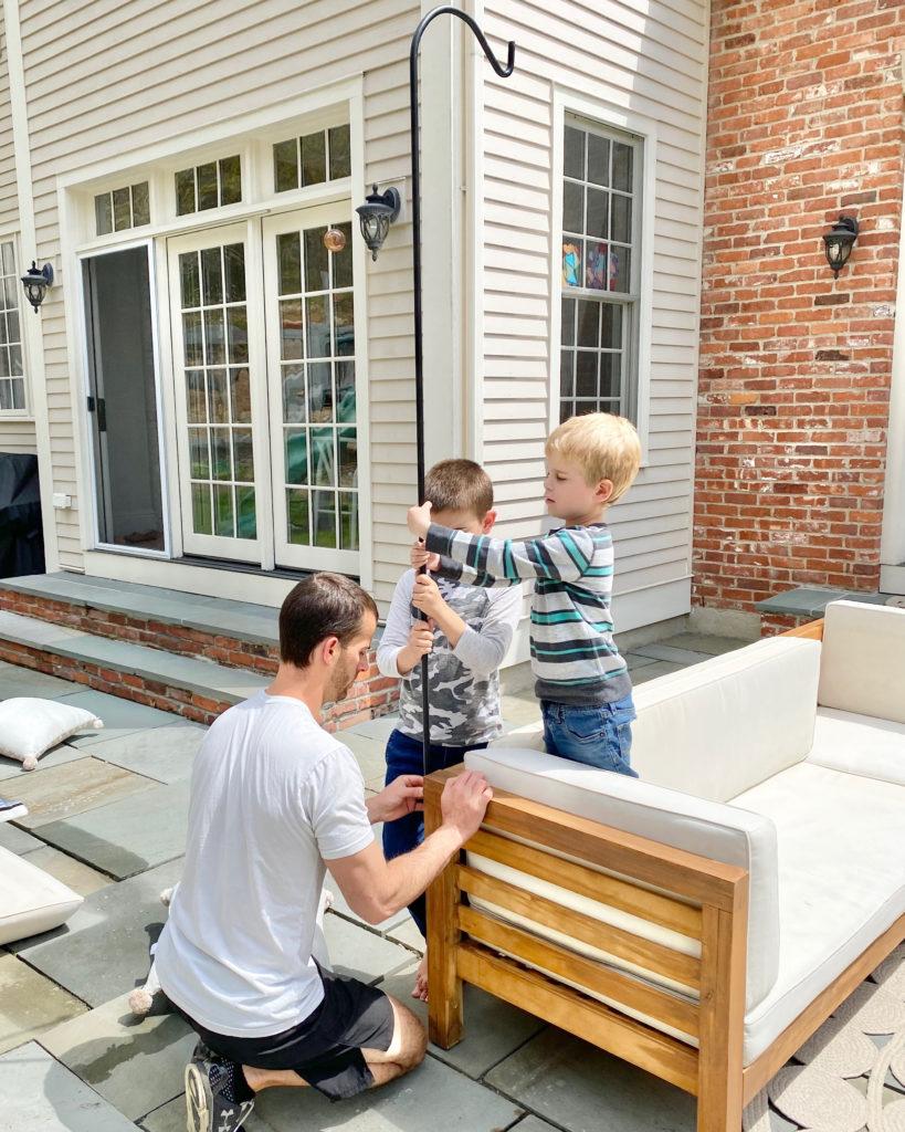 installing poles to hang patio string lights - pinteresting plans blog