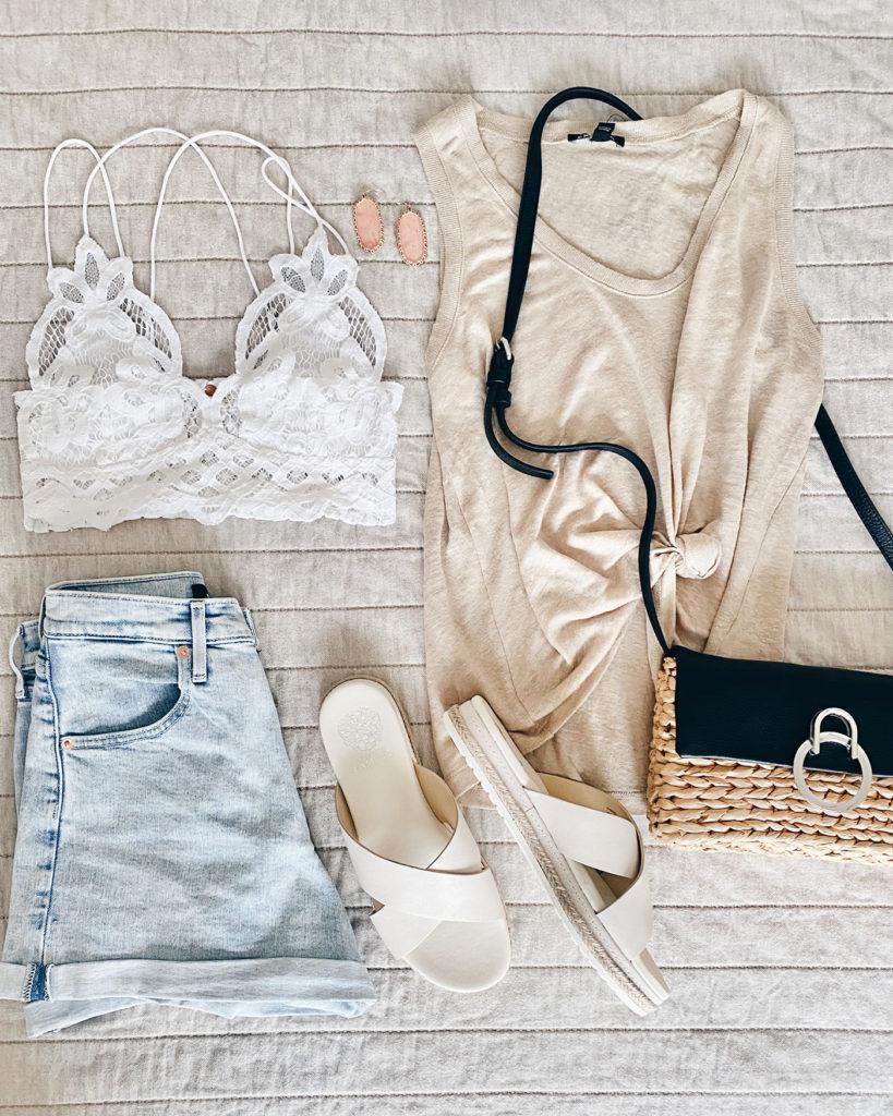 flat lay - beige linen tank high waist jean shorts and summer accessories