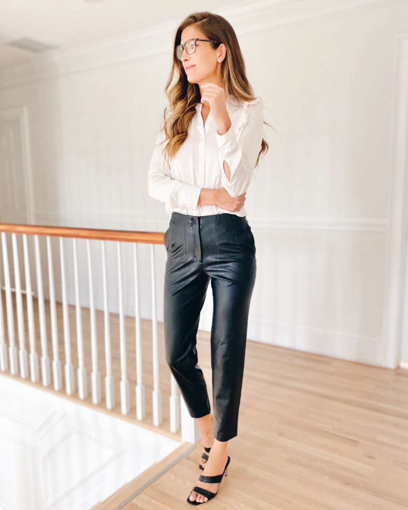 black faux leather pants with white dressy top outfit