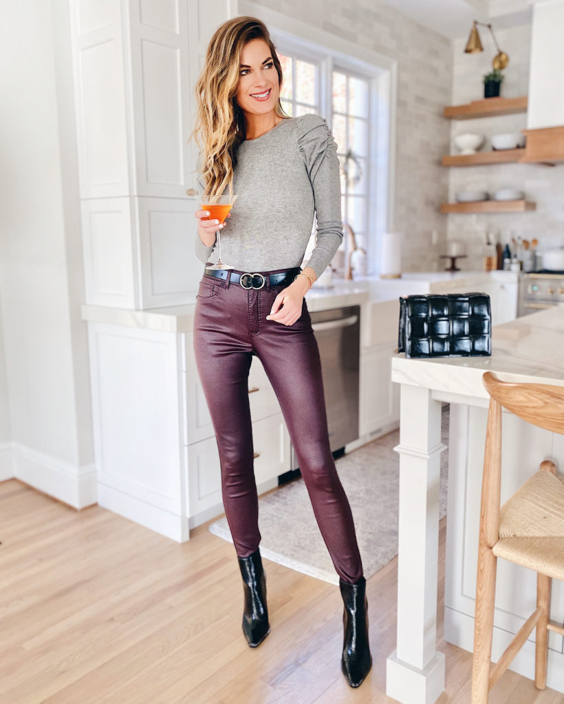 holiday outfit ideas 2020 - coated jeans with puff shoulder sweater