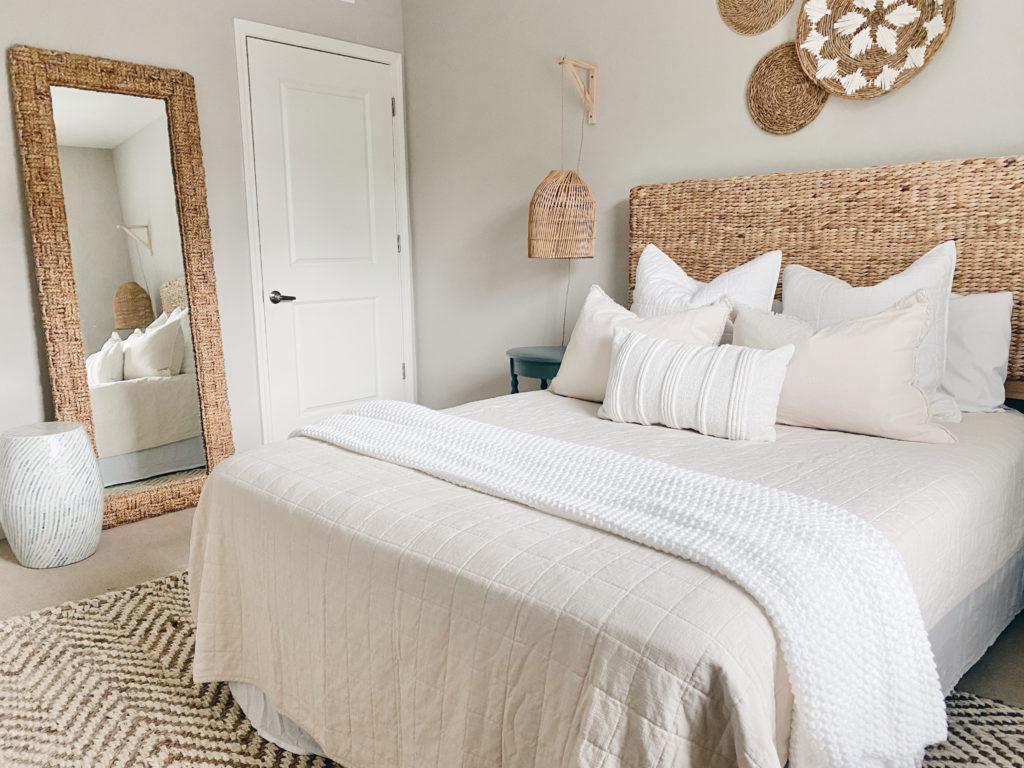 layered neutral bedding in a modern coastal beach bedroom